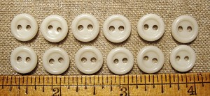 "China, 2 hole button, just less than 3/8"", Priced per dozen"